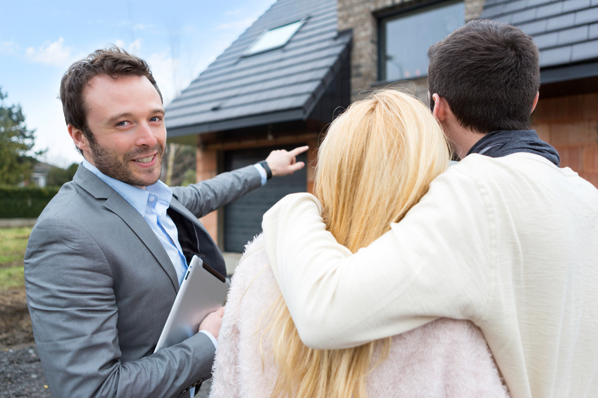 View of a Real estate agent shows details to customers