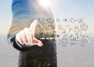 businessman-pointing-graphs-symbols_1232-917